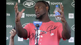 """FILE - In this July 25, 2019, file photo, New York Jets running back Le'Veon Bell speaks to reporters after a practice at the NFL football team's training camp in Florham Park, N.J. Bell was in fifth grade when he realized he couldn't shake music from his mind. """"That's when I really realized I loved music,"""" the star running back recalled in an interview with The Associated Press in the players' lobby in the New York Jets' facility. (AP Photo/Seth Wenig, File)"""