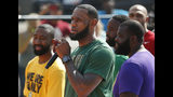 LeBron James speaks during the debut of the new basketball court at I Promise School, Wednesday, Aug. 14, 2019, in Akron, Ohio. The NBA superstar is spending more than $1 million on various upgrades for the school. (Jeff Lange/Akron Beacon Journal via AP)