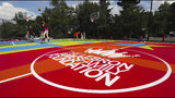 Students shoot around after the debut of the new basketball court at I Promise School, Wednesday, Aug. 14, 2019 in Akron, Ohio. LeBron James helped unveil the multicolored outdoor court at the school, which has just started its second academic year and now serves more than 300 students from grades 3-5. (Jeff Lange/Akron Beacon Journal via AP)