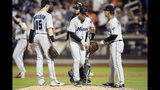 Miami Marlins manager Don Mattingly, right, takes relief pitcher Jeff Brigham, center, out of a baseball game after Brigham gave up three home runs during the seventh inning in the second game of a doubleheader against the New York Mets, Monday, Aug. 5, 2019, in New York. (AP Photo/Mary Altaffer)