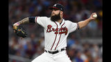Atlanta Braves' Dallas Keuchel pitches against the New York Mets during the first inning of a baseball game Wednesday, Aug. 14, 2019, in Atlanta. (AP Photo/John Amis)