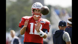 New England Patriots quarterback Tom Brady (12) catches a ball during a combined NFL football training camp with the Tennessee Titans Wednesday, Aug. 14, 2019, in Nashville, Tenn. (AP Photo/Mark Humphrey)