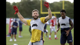 New England Patriots wide receiver Julian Edelman stretches during a combined NFL football training camp with the Tennessee Titans Wednesday, Aug. 14, 2019, in Nashville, Tenn. (AP Photo/Mark Humphrey)