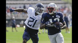 Tennessee Titans cornerback Malcolm Butler (21) defends against New England Patriots wide receiver Phillip Dorsett during a combined NFL football training camp Wednesday, Aug. 14, 2019, in Nashville, Tenn. (AP Photo/Mark Humphrey)