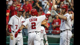 Washington Nationals' Adam Eaton celebrates his three-run homer with Trea Turner (7) and Stephen Strasburg during the fifth inning of a baseball game against the Cincinnati Reds at Nationals Park, Wednesday, Aug. 14, 2019, in Washington. (AP Photo/Alex Brandon)