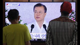 """People watch a TV screen showing a live broadcast of South Korean President Moon Jae-in's speech during a ceremony to celebrate the Korean Liberation Day, marking the 74th anniversary of Korea's liberation from the Japanese colonial rule, at the Seoul Railway Station in Seoul, South Korea, Thursday, Aug. 15, 2019. The signs read: """"Korean Liberation Day.""""(AP Photo/Ahn Young-joon)"""
