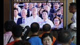 "People watch a TV screen showing a live broadcast of South Korean President Moon Jae-in, center left, and his wife Kim Jung-sook during a ceremony to celebrate the Korean Liberation Day, marking the 74th anniversary of Korea's liberation from the Japanese colonial rule, at the Seoul Railway Station in Seoul, South Korea, Thursday, Aug. 15, 2019. The signs read: ""Korean Liberation Day.""(AP Photo/Ahn Young-joon)"