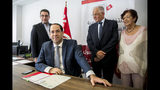 Tunisian Prime Minister Youssef Chahed submits his candidacy for the upcoming early presidential elections in Tunis, Tunisia. Friday, Aug. 9, 2019. (AP Photo/Hassene Dridi)
