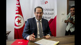 Tunisian Prime Minister Youssef Chahed submits his candidacy for the upcoming early presidential elections in Tunis, Tunisia, Friday, Aug. 9, 2019. (AP Photo/Hassene Dridi)