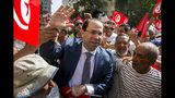 Tunisian Prime Minister Youssef Chahed, center, arrives to submit his candidacy for the upcoming early presidential elections in Tunis, Tunisia, Friday, Aug. 9, 2019. (AP Photo/Hassene Dridi)