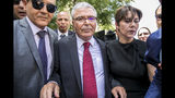 Tunisian Defense Minister Abdelkrim Zbidi, center, leaves after submitting his candidacy for the upcoming early presidential elections in Tunis, Tunisia. Wednesday, Aug. 7, 2019. (AP Photo/Hassene Dridi)