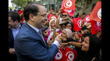 Tunisian Prime Minister Youssef Chahed arrives to submit his candidacy for the upcoming early presidential elections in Tunis, Tunisia, Friday, Aug. 9, 2019. (AP Photo/Hassene Dridi)