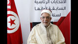 First Vice President of the Assembly Abdelfattah Mourou submits his candidacy for the upcoming early presidential elections in Tunis, Tunisia, Friday, Aug. 9, 2019. (AP Photo/Hassene Dridi)
