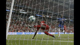 Liverpool's Sadio Mane, left, scores his side's first goal during the UEFA Super Cup soccer match between Liverpool and Chelsea, in Besiktas Park, in Istanbul, Wednesday, Aug. 14, 2019. (AP Photo/Thanassis Stavrakis)
