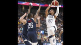 Team White guard Jalen Brunson (60) goes up for a shot under pressure from Team Blue guard Kemba Walker (26) during the first half of the U.S. men's basketball team's scrimmage in Las Vegas, Friday, Aug. 9, 2019. (Erik Verduzco/Las Vegas Review-Journal via AP)