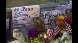 FILE - In this Aug. 4, 2019 file photo, a Virgin Mary painting, flags and flowers adorn a makeshift memorial for the victims of the mass shooting at a Walmart in El Paso, Texas. A man whose 63-year-old wife was among the Texas mass shooting victims says he has no other family and welcomes anyone wanting to attend her services in El Paso. Margie Reckard was among 22 people fatally shot on Aug. 3 at a the Walmart. Reckard and Antonio Basco were married 22 years. (AP Photo/Andres Leighton, File)