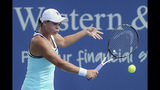 Ashleigh Barty, of Australia, returns to Maria Sakkari, of Greece, during the Western & Southern Open tennis tournament, Friday, Aug. 16, 2019, in Mason, Ohio. (AP Photo/John Minchillo)
