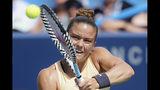Maria Sakkari, of Greece, returns to Ashleigh Barty, of Australia, during the Western & Southern Open tennis tournament, Friday, Aug. 16, 2019, in Mason, Ohio. (AP Photo/John Minchillo)