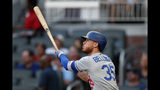 Los Angeles Dodgers' Cody Bellinger watches the flight of a solo home run in the first inning of a baseball game against the Atlanta Braves, Friday, Aug. 16, 2019, in Atlanta. (AP Photo/John Bazemore)
