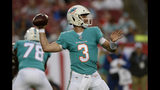 Miami Dolphins quarterback Josh Rosen (3) throws a pass against the Tampa Bay Buccaneers during the first half of an NFL preseason football game Friday, Aug. 16, 2019, in Tampa, Fla. (AP Photo/Jason Behnken)