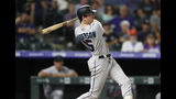 Miami Marlins' Brian Anderson watches a single off Colorado Rockies relief pitcher Scott Oberg during the ninth inning of a baseball game Friday, Aug. 16, 2019, in Denver. The Rockies won 3-0. (AP Photo/David Zalubowski)