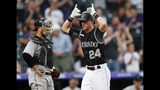 Colorado Rockies' Ryan McMahon gestures as he crosses home plate after hitting a two-run home run off Miami Marlins starting pitcher Sandy Alcantara, as catcher Bryan Holaday stands nearby during the second inning of a baseball game Friday, Aug. 16, 2019, in Denver. (AP Photo/David Zalubowski)