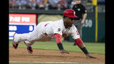 Philadelphia Phillies' Jean Segura dives into third base during the second inning of the team's baseball game against the San Diego Padres on Friday, Aug. 16, 2019, in Philadelphia. (AP Photo/Matt Rourke)