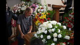 Antonio Basco, companion of Margie Reckard, leans on her casket during her funeral at La Paz Faith Memorial & Spiritual Center, Friday, Aug. 16, 2019, in El Paso, Texas. Reckard was killed during the mass shooting on Aug. 3. (AP Photo/Jorge Salgado)
