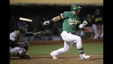 Oakland Athletics' Robbie Grossman swings for the game-winning hit in the 13th inning of a baseball game against the Houston Astros Friday, Aug. 16, 2019, in Oakland, Calif. (AP Photo/Ben Margot)