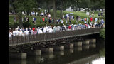 """Fans shelter from the rain as they walk round the course during the third round of the BMW Championship golf tournament at Medinah Country Club, Saturday, Aug. 17, 2019, in Medinah, Ill. The National Weather Service is warning of widespread severe weather Monday, beginning with scattered showers throughout the day and culminating tonight with the possibility of winds of up to 70 mph, quarter-sized hail, flooding and """"a tornado or two possible."""" (AP Photo/Nam Y. Huh)"""