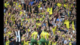 Norwich City's Teemu Pukki celebrates scoring his side's first goal of the game with fans, during the English Premier League soccer match between Norwich City and Newcastle United, at Carrow Road, in Norwich, England, Saturday, Aug.17, 2019. (Joe Giddens/PA via AP)
