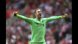 Liverpool goalkeeper Adrian celebrates Sadio Mane's first goal of the game, during the English Premier League soccer match between Southampton and Liverpool, at St Mary's, in Southampton, England, Saturday, Aug. 17, 2019. (Steven Paston/PA via AP)