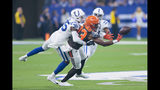 Cleveland Browns wide receiver D.J. Montgomery (83) drops a pass as he is hit by Indianapolis Colts cornerback Pierre Desir (35) during the first half of an NFL preseason football game in Indianapolis, Saturday, Aug. 17, 2019. (AP Photo/AJ Mast)