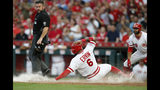 Cincinnati Reds' Phillip Ervin scores on single by Jose Iglesias off St. Louis Cardinals starting pitcher Miles Mikolas during the fourth inning of a baseball game Saturday, Aug. 17, 2019, in Cincinnati. (AP Photo/Gary Landers)