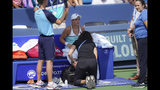 Ashleigh Barty, of Australia, receives a medical time-out during a match against Svetlana Kuznetsova, of Russia, during the Western & Southern Open tennis tournament, Saturday, Aug. 17, 2019, in Mason, Ohio. (AP Photo/John Minchillo)