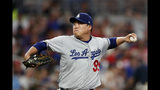 Los Angeles Dodgers starting pitcher Hyun-Jin Ryu works against the Atlanta Braves in the fourth inning of a baseball game Saturday, Aug. 17, 2019, in Atlanta. (AP Photo/John Bazemore)