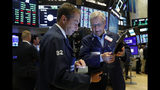 Traders Dudley Devine, left, and Christopher Fuchs work on the floor of the New York Stock Exchange, Friday, Aug. 16, 2019. Stocks are opening broadly higher at the end of a turbulent week. (AP Photo/Richard Drew)