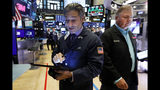 Traders John Romolo, left, and George Ettinger work on the floor of the New York Stock Exchange, Friday, Aug. 16, 2019. Stocks are opening broadly higher at the end of a turbulent week. (AP Photo/Richard Drew)