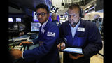 Specialist Christopher Riggs, left, and trader Michael Milano work on the floor of the New York Stock Exchange, Specialist Christopher Riggs, left, and trader Michael Milano work Friday, Aug. 16, 2019. Stocks are opening broadly higher at the end of a turbulent week. (AP Photo/Richard Drew)