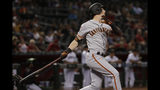 San Francisco Giants' Mike Yastrzemski follows through on a solo home run during the 11th inning of the team's baseball game against the Arizona Diamondbacks, Friday, Aug. 16, 2019, in Phoenix. It was Yastrzemski's third home run of the game. (AP Photo/Matt York)