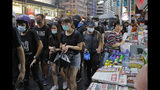 Protesters march during the anti-extradition bill protest in Hong Kong Saturday, Aug. 17, 2019. Another weekend of protests is underway in Hong Kong as Mainland Chinese police are holding drills in nearby Shenzhen, prompting speculation they could be sent in to suppress the protests. (AP Photo/Kin Cheung)