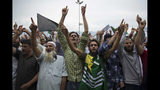 Kashmiri Muslims shout pro-freedom slogans during a demonstration after Friday prayers amid curfew like restrictions in Srinagar, India, Friday, Aug. 16, 2019. Hundreds of people have held a street protest in Indian-controlled Kashmir as India's government assured the Supreme Court that the situation in the disputed region is being reviewed daily and unprecedented security restrictions will be removed over the next few days. (AP Photo/Dar Yasin)
