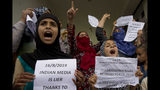 Kashmiri Muslim women and young girls hold placards and shout pro-freedom slogans during a demonstration after Friday prayers amid curfew like restrictions in Srinagar, India, Friday, Aug. 16, 2019. Hundreds of people have held a street protest in Indian-controlled Kashmir as India's government assured the Supreme Court that the situation in the disputed region is being reviewed daily and unprecedented security restrictions will be removed over the next few days. (AP Photo/Dar Yasin)