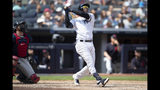 New York Yankees' Didi Gregorius watches the ball after hitting a home run during the fourth inning of a baseball game against the Cleveland Indians, Saturday, Aug. 17, 2019, in New York. (AP Photo/Mary Altaffer)