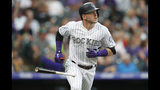 Colorado Rockies' Trevor Story drops the bat as he heads up the first-base line while watching his two-run home run off Miami Marlins starting pitcher Hector Noesi during the second inning of a baseball game Saturday, Aug. 17, 2019, in Denver. (AP Photo/David Zalubowski)