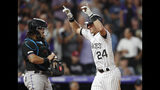 Colorado Rockies' Ryan McMahon, right, gestures as he crosses home plate after hitting a solo home run off Miami Marlins relief pitcher Adam Conley, next to catcher Jorge Alfaro during the sixth inning of a baseball game Saturday, Aug. 17, 2019, in Denver. (AP Photo/David Zalubowski)