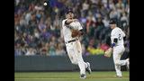 Colorado Rockies third baseman Nolan Arenado throws to first base to put out Miami Marlins' Starlin Castro during the sixth inning of a baseball game Saturday, Aug. 17, 2019, in Denver. (AP Photo/David Zalubowski)
