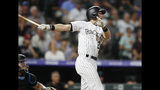 Colorado Rockies' Ryan McMahon watches his solo home run off Miami Marlins relief pitcher Wei-Yin Chen during the seventh inning of a baseball game Saturday, Aug. 17, 2019, in Denver. (AP Photo/David Zalubowski)