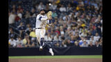 FILE - In this Aug. 8, 2019, file photo, San Diego Padres shortstop Fernando Tatis Jr. throws to first base late on a single by Colorado Rockies' Yonathan Daza during the sixth inning of a baseball game, in San Diego. Padres rookie shortstop Fernando Tatis Jr. has become one of major league baseball's most exciting young players, showing an instinct and aggressiveness that make it hard to believe he's only 20. (AP Photo/Orlando Ramirez, File)