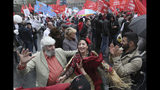 People dance as the communist party supporters wave red flags during a protest in the center of Moscow, Russia, Saturday, Aug. 17, 2019. People rallied Saturday against the exclusion of some city council candidates from Moscow's upcoming election. (AP Photo)